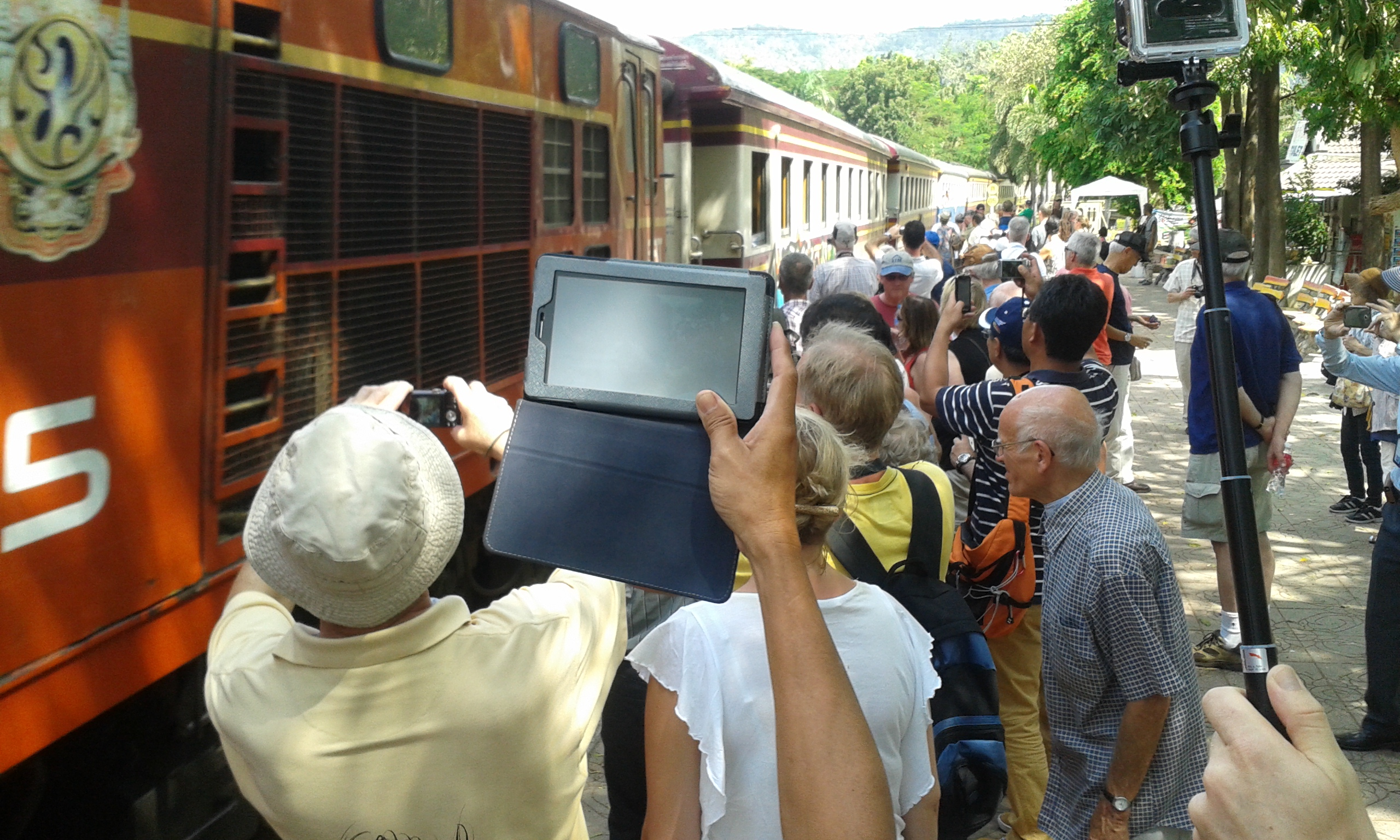 Tourists taking images of a train. Thailand, 2013.
